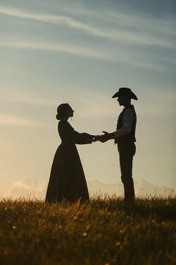 Magdalena Russocka historical couple standing in field at sunset