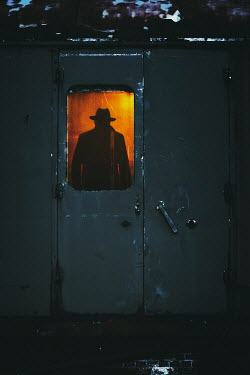 Nic Skerten SILHOUETTED MAN WITH HAT STANDING IN TRAIN Men