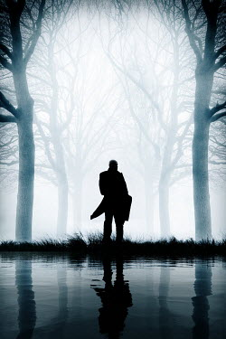 Nic Skerten SILHOUETTED MAN BY RIVER WITH TREES IN FOG Men