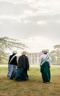 Stephen Mulcahey THREE EDWARDIAN WOMEN WALKING TO GRAND HOUSE Groups/Crowds