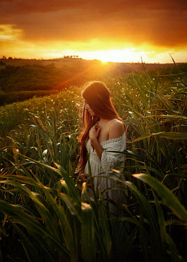 Terrence Drysdale WOMAN IN WHITE DRESS IN FIELD AT SUNSET Women