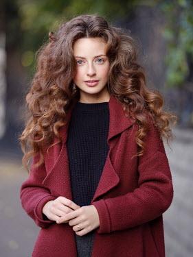 Alexey Kazantsev BRUNETTE GIRL WITH LONG CURLY HAIR OUTDOORS Women
