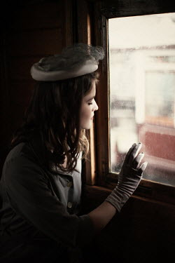 Nikaa 1940S WOMAN SITTING BY WINDOW IN TRAIN Women