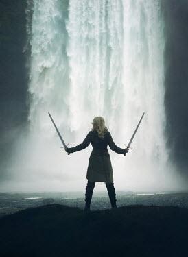 Mark Owen BLONDE WOMAN WITH SWORDS BY WATERFALL Women