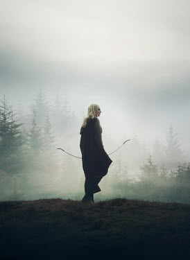 Mark Owen BLONDE WOMAN WITH BOW BY FOGGY FOREST Women