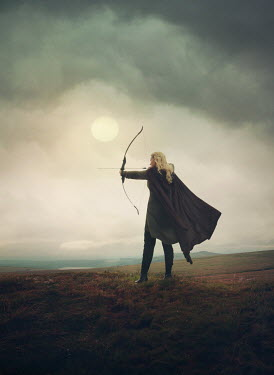 Mark Owen BLONDE WOMAN SHOOTING ARROW IN COUNTRYSIDE Women