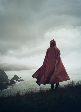Mark Owen WOMAN IN RED CAPE WATCHING FOGGY SEA Women