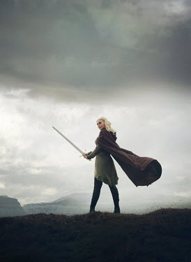 Mark Owen WOMAN WITH CAPE AND SWORD IN COUNTRYSIDE Women