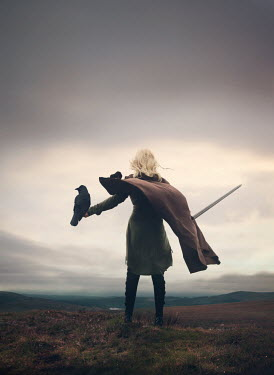 Mark Owen WOMAN WITH CAPE SWORD AND BIRD ON ARM OUTDOORS Women