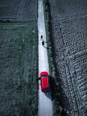 Magdalena Russocka woman and man by car on empty country road from above