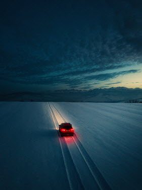 Magdalena Russocka CAR WITH RED LIGHTS IN SNOWY COUNTRYSIDE AT DUSK