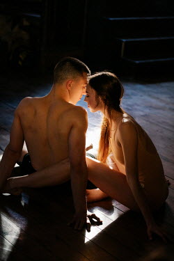 Marta Syrko INTIMATE COUPLE SITTING ON FLOOR IN SHADOW Couples