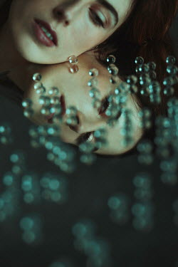 Alisa Andrei WOMAN REFLECTED IN MORROR WITH FALLING BEADS Women