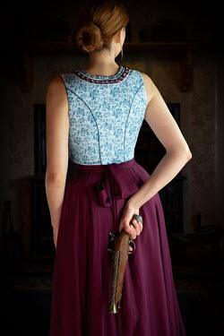 Natasza Fiedotjew WOMAN HOLDING GUN BEHIND BACK Women