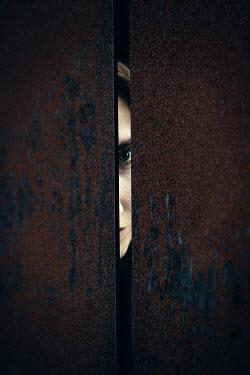Natasza Fiedotjew woman peeping through gap in rusty surface