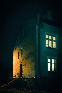 Natasza Fiedotjew town house with glowing window at night