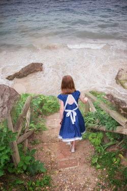 Elisabeth Ansley LITTLE GIRL ON STEPS DOWN TO BEACH Children