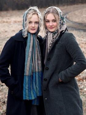 Elisabeth Ansley TWO GIRLS IN HEADSCARVES IN COUNTRYSIDE Women