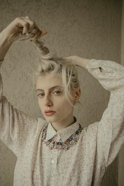 Irene Gittarelli BLONDE WOMAN TWISTING HAIR Women