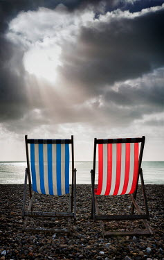 Maggie McCall TWO STRIPY DECKCHAIRS ON PEBBLE BEACH Miscellaneous Objects