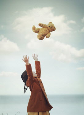 Mark Owen LITTLE GIRL BY SEA THROWING TEDDY IN AIR Children
