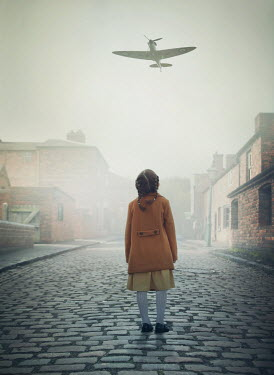 Mark Owen LITTLE GIRL IN COBBLED STREET WATCHING WARPLANE Children