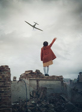 Mark Owen LITTLE GIRL ON RUBBLE WAVING AT WARPLANE Children