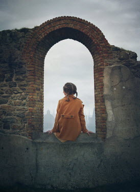 Mark Owen LITTLE GIRL SITTING IN WINDOW OF RUINED BUILDING Children