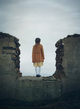 Mark Owen LITTLE GIRL STANDING IN BOMBED BUILDING Children