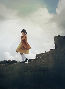 Mark Owen LITTLE GIRL WALKING ON DAMAGED BUILDING Children
