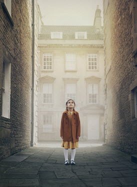 Mark Owen LITTLE GIRL STANDING BY BUILDINGS WATCHING SKY Children