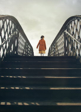 Mark Owen LITTLE GIRL STANDING ON IRON FOOTBRIDGE Children