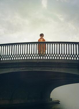 Mark Owen LITTLE GIRL STANDING ON BRIDGE OVER RIVER Children
