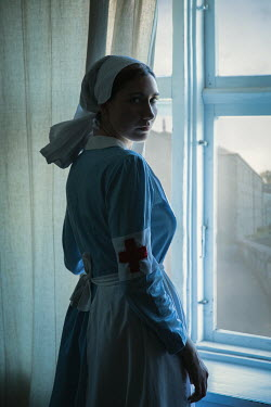 Natasza Fiedotjew war nurse standing by window