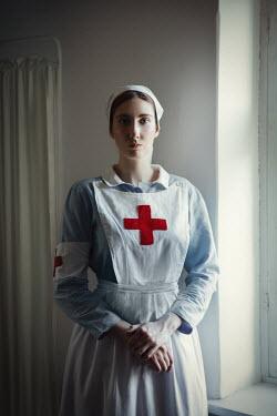 Natasza Fiedotjew war nurse standing by window