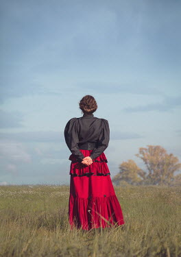 Joanna Czogala HISTORICAL BRUNETTE WOMAN STANDING IN FIELD Women
