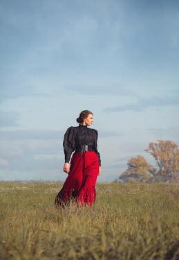 Joanna Czogala HISTORICAL BRUNETTE WOMAN WALKING IN FIELD Women