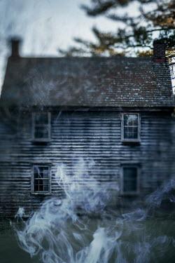 Lisa Bonowicz OLD WOODEN HOUSE WITH SMOKE OUTSIDE Houses