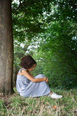 Miguel Sobreira SAD YOUNG GIRL SITTING BY TREE IN PARK Children