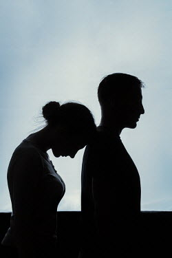 Magdalena Russocka silhouetted young couple embacing inside