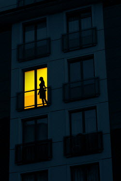 Magdalena Russocka silhouette of woman in balcony door of modern apartment at night