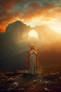 Terrence Drysdale WOMAN IN CAPE BY ARCHED CLIFF AT SUNSET Women