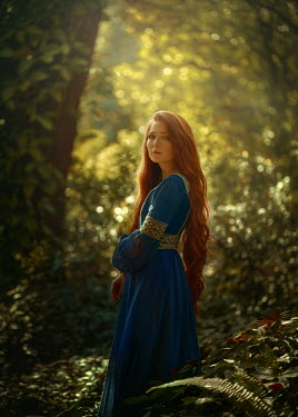 Terrence Drysdale MEDIEVAL WOMAN WITH RED HAIR STANDING IN FOREST Women