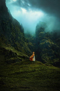 Terrence Drysdale WOMAN IN CAPE STANDING ON MISTY MOUNTAIN Women