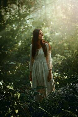 Terrence Drysdale WORRIED BRUNETTE WOMAN STANDING IN FOREST Women