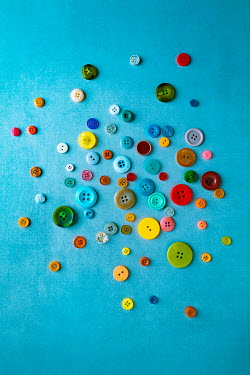 Magdalena Wasiczek MULTI-COLOURED BUTTONS ON TURQUOISE BACKGROUND Miscellaneous Objects
