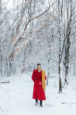 Matilda Delves BLONDE WOMAN WITH RED COAT IN SNOWY COUNTRYSIDE Women