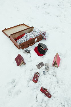Matilda Delves OPEN SUITCASE AND SCATTERED OBJECTS IN SNOW Miscellaneous Objects