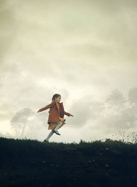 Mark Owen LITTLE GIRL WITH COAT RUNNING IN FOGGY FIELD Children