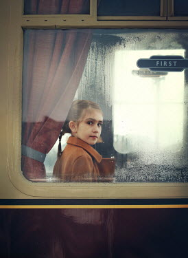 Mark Owen LITTLE GIRL SITTING IN RETRO TRAIN Children